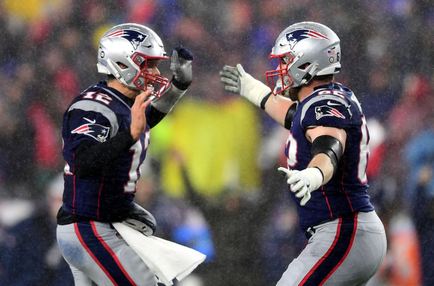 FOXBOROUGH, MASSACHUSETTS - NOVEMBER 24: Tom Brady #12 of the New England Patriots celebrates with Joe Thuney #62 after throwing a touchdown pass during the first quarter against the Dallas Cowboys in the game at Gillette Stadium on November 24, 2019 in Foxborough, Massachusetts. (Photo by Billie Weiss/Getty Images)