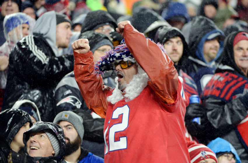 FOXBOROUGH, MASSACHUSETTS - NOVEMBER 24: A fan cheers in the game between the New England Patriots and the Dallas Cowboys at Gillette Stadium on November 24, 2019 in Foxborough, Massachusetts. (Photo by Kathryn Riley/Getty Images)