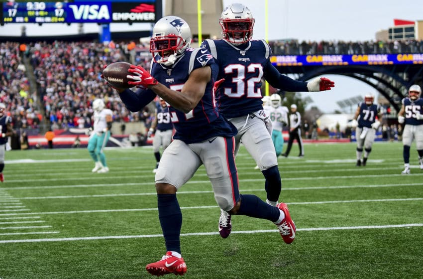 FOXBOROUGH, MA - DECEMBER 29: J.C. Jackson #27 and Devin McCourty #32 of the New England Patriots react during the fourth quarter of a game against the Miami Dolphins at Gillette Stadium on December 29, 2019 in Foxborough, Massachusetts. (Photo by Billie Weiss/Getty Images)