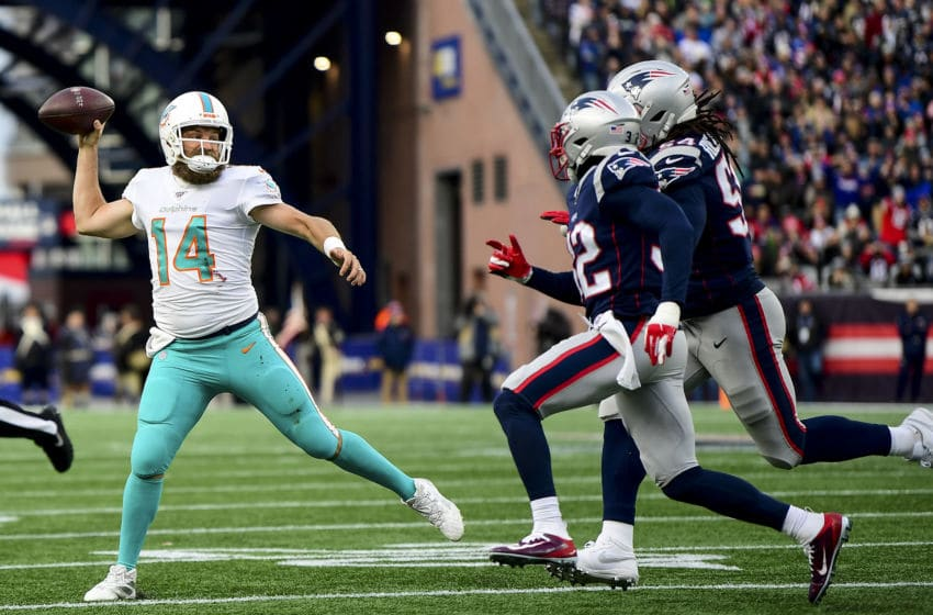 FOXBOROUGH, MA - DECEMBER 29: Ryan Fitzpatrick #14 of the Miami Dolphins throws during the fourth quarter of a game against the Ryan Fitzpatrick at Gillette Stadium on December 29, 2019 in Foxborough, Massachusetts. (Photo by Billie Weiss/Getty Images)