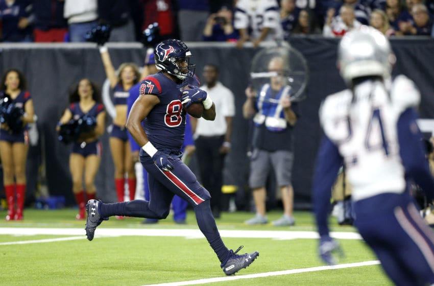 HOUSTON, TEXAS - DECEMBER 01: Darren Fells #87 of the Houston Texans scores a touchdown against the New England Patriots during the second quarter in the game at NRG Stadium on December 01, 2019 in Houston, Texas. (Photo by Bob Levey/Getty Images)