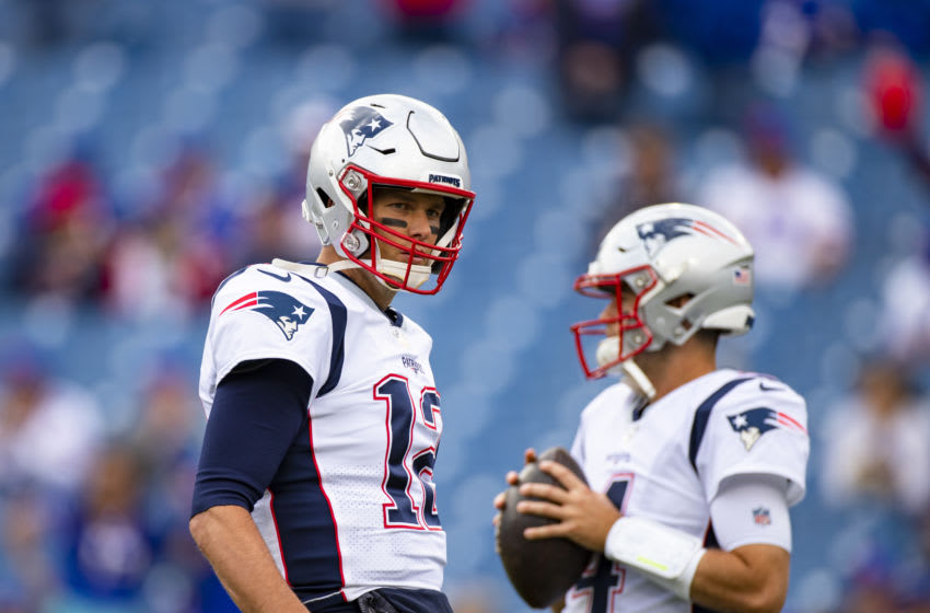 Tom Brady #12 and Jarrett Stidham #4 of the New England Patriots warms up before the game against the Buffalo Bills at New Era Field on September 29, 2019 in Orchard Park, New York. New England defeats Buffalo 16-10. (Photo by Brett Carlsen/Getty Images)
