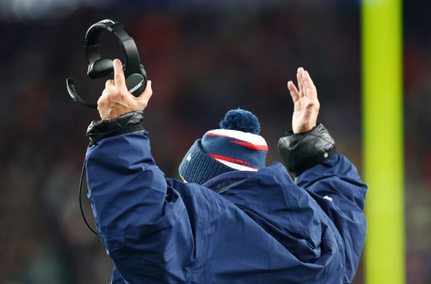 FOXBOROUGH, MASSACHUSETTS - DECEMBER 08: Head coach Bill Belichick of the New England Patriots signals for a touchdown during the second half against the Kansas City Chiefs in the game at Gillette Stadium on December 08, 2019 in Foxborough, Massachusetts. (Photo by Adam Glanzman/Getty Images)