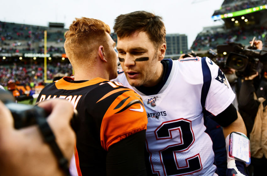 CINCINNATI, OHIO - DECEMBER 15: Andy Dalton #14 of the Cincinnati Bengals shakes hands with Tom Brady #12 of the New England Patriots after the Patriots defeated the Bengals 34-13 in the game at Paul Brown Stadium on December 15, 2019 in Cincinnati, Ohio. (Photo by Bobby Ellis/Getty Images)