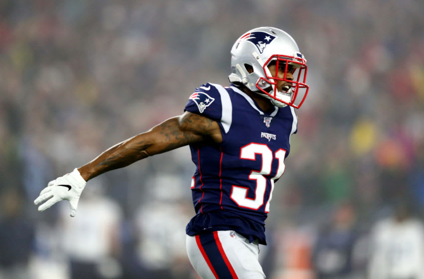 FOXBOROUGH, MASSACHUSETTS - JANUARY 04: Jonathan Jones #31 of the New England Patriots reacts in the AFC Wild Card Playoff game against the Tennessee Titans at Gillette Stadium on January 04, 2020 in Foxborough, Massachusetts. (Photo by Adam Glanzman/Getty Images)