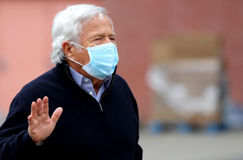 FOXBOROUGH, MASSACHUSETTS - MAY 08: New England Patriots owner Robert Kraft waves to passing cars at the