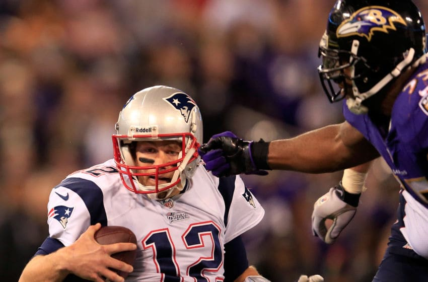 BALTIMORE, MD - DECEMBER 22: Quarterback Tom Brady #12 of the New England Patriots is sacked by outside linebacker Terrell Suggs #55 of the Baltimore Ravens during the second half at M&T Bank Stadium on December 22, 2013 in Baltimore, Maryland. (Photo by Rob Carr/Getty Images)
