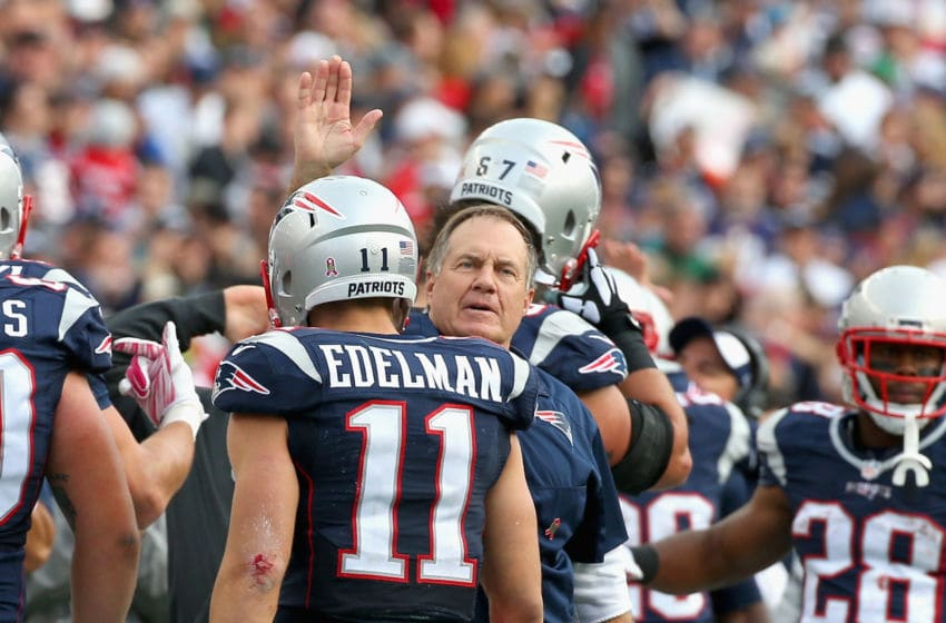 FOXBORO, MA - OCTOBER 25: Head coach Bill Belichick reacts with Julian Edelman #11 of the New England Patriots during the fourth quarter against the New York Jets at Gillette Stadium on October 25, 2015 in Foxboro, Massachusetts. (Photo by Jim Rogash/Getty Images)