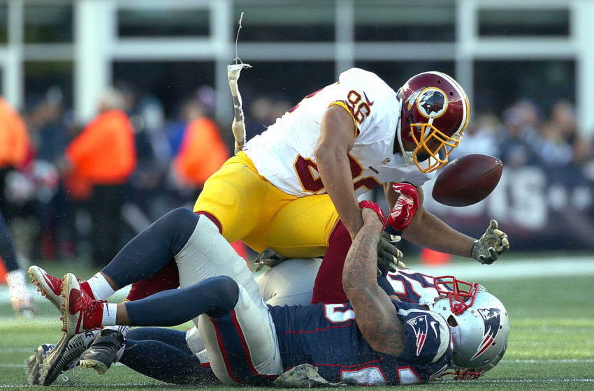 FOXBORO, MA - NOVEMBER 8: Jordan Reed #86 of the Washington Redskins bobbles the ball under the pressure of Patrick Chung #23 of the New England Patriots in the second half at Gillette Stadium on November 8, 2015 in Foxboro, Massachusetts. (Photo by Jim Rogash/Getty Images)
