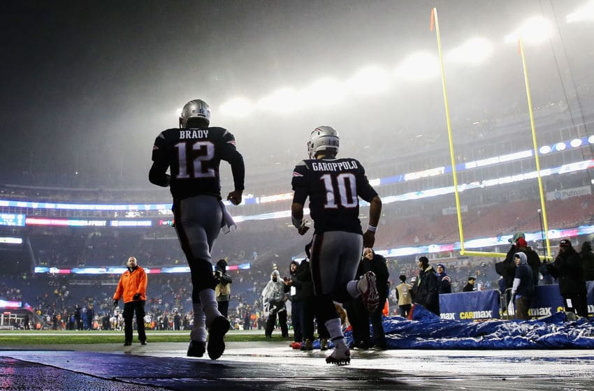 FOXBORO, MA - JANUARY 22: Tom Brady #12 and Jimmy Garoppolo #10 of the New England Patriots run onto the field prior to the AFC Championship Game against the Pittsburgh Steelers at Gillette Stadium on January 22, 2017 in Foxboro, Massachusetts. (Photo by Maddie Meyer/Getty Images)