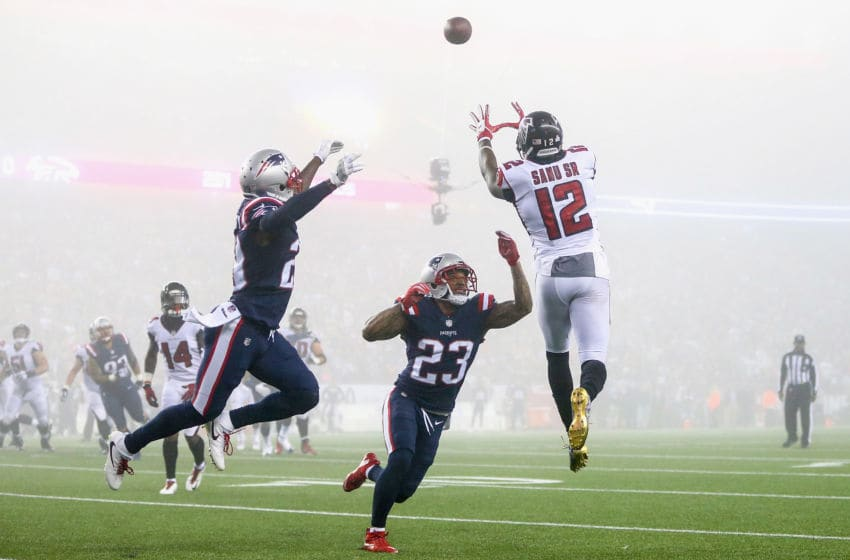FOXBORO, MA - OCTOBER 22: Mohamed Sanu #12 of the Atlanta Falcons catches a pass as he is defended by Patrick Chung #23 of the New England Patriots during the fourth quarter of a game against the Atlanta Falcons at Gillette Stadium on October 22, 2017 in Foxboro, Massachusetts. (Photo by Adam Glanzman/Getty Images)