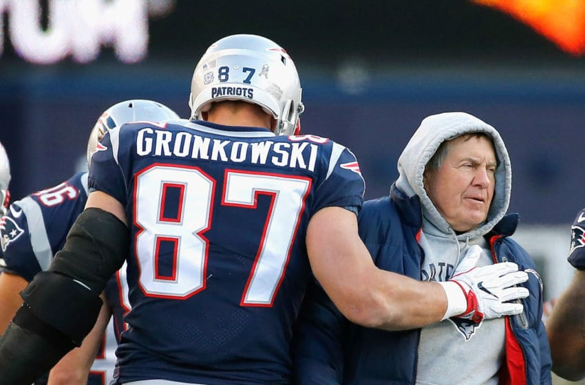 FOXBORO, MA - NOVEMBER 26: Rob Gronkowski #87 of the New England Patriots reacts with head coach Bill Belichick after catching a touchdown pass during the third quarter of a game against the Miami Dolphins at Gillette Stadium on November 26, 2017 in Foxboro, Massachusetts. (Photo by Jim Rogash/Getty Images)