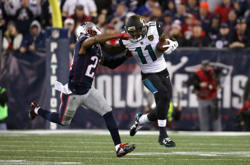 FOXBOROUGH, MA - JANUARY 21: Marqise Lee #11 of the Jacksonville Jaguars carries the ball after a catch as he is defended by Malcolm Butler #21 of the New England Patriots in the second half during the AFC Championship Game at Gillette Stadium on January 21, 2018 in Foxborough, Massachusetts. (Photo by Jim Rogash/Getty Images)