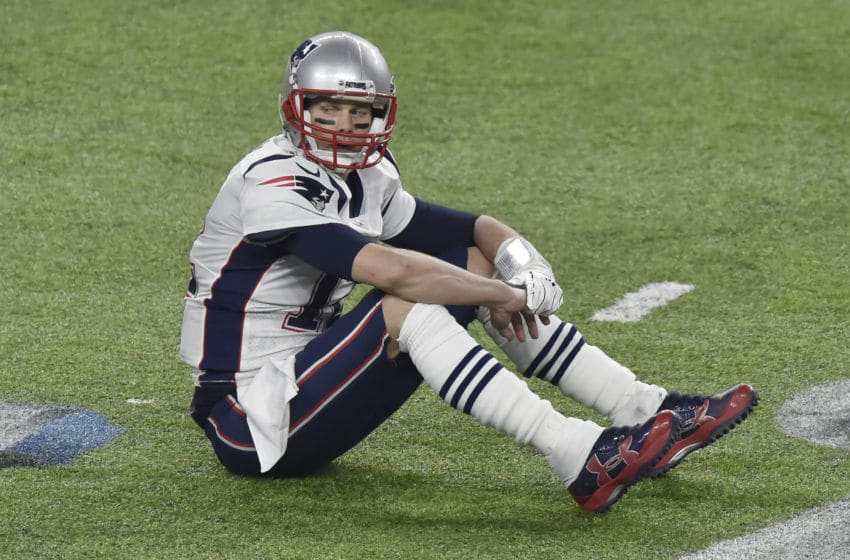 MINNEAPOLIS, MN - FEBRUARY 04: Tom Brady #12 of the New England Patriots sits on the field an looks on after a play against the Philadelphia Eagles during Super Bowl LII at U.S. Bank Stadium on February 4, 2018 in Minneapolis, Minnesota. The Eagles defeated the Patriots 41-33. (Photo by Focus on Sport/Getty Images) *** Local Caption *** Tom Brady