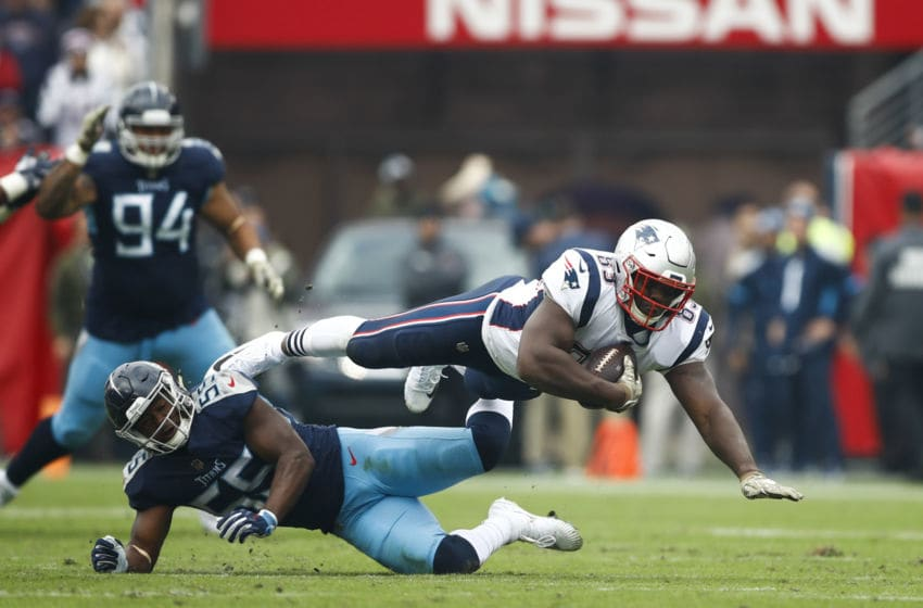 NASHVILLE, TN - NOVEMBER 11: Dwayne Allen #83 of the New England Patriots dives over Jayon Brown #55 of the Tennessee Titans with the ball during the second quarter at Nissan Stadium on November 11, 2018 in Nashville, Tennessee. (Photo by Wesley Hitt/Getty Images)