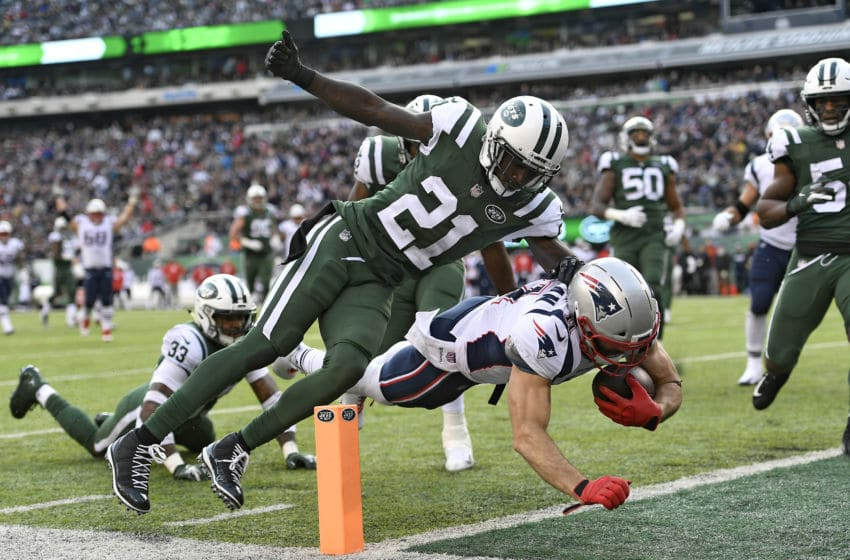 EAST RUTHERFORD, NEW JERSEY - NOVEMBER 25: Julian Edelman #11 of the New England Patriots dives into the end zone for a third quarter touchdown past Morris Claiborne #21 of the New York Jets at MetLife Stadium on November 25, 2018 in East Rutherford, New Jersey. (Photo by Sarah Stier/Getty Images)