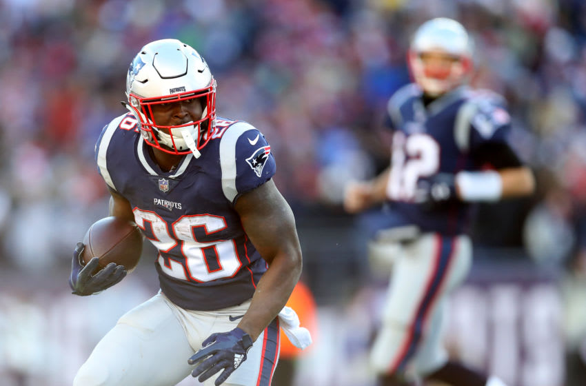 FOXBOROUGH, MASSACHUSETTS - DECEMBER 23: Sony Michel #26 of the New England Patriots runs with the ball during the game against the Buffalo Bills at Gillette Stadium on December 23, 2018 in Foxborough, Massachusetts. (Photo by Maddie Meyer/Getty Images)