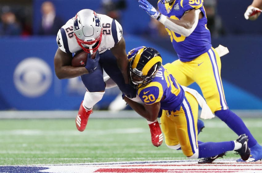 ATLANTA, GA - FEBRUARY 03: Sony Michel #26 of the New England Patriots is tackled by Lamarcus Joyner #20 of the Los Angeles Rams in the first half of the Super Bowl LIII at Mercedes-Benz Stadium on February 3, 2019 in Atlanta, Georgia. (Photo by Jamie Squire/Getty Images)