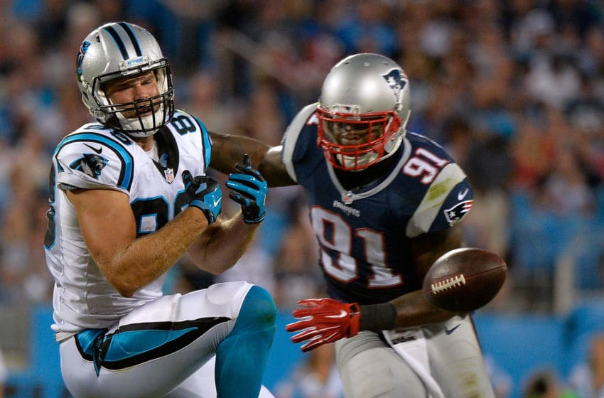 CHARLOTTE, NC - AUGUST 28: Jamie Collins #91 of the New England Patriots defends a pass to Greg Olsen #88 of the Carolina Panthers during their preseason NFL game at Bank of America Stadium on August 28, 2015 in Charlotte, North Carolina. (Photo by Grant Halverson/Getty Images)