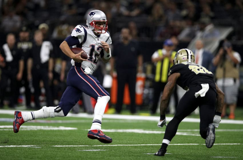 NEW ORLEANS, LA - SEPTEMBER 17: Tom Brady #12 of the New England Patriots runs with the ball against the New Orleans Saints at the Mercedes-Benz Superdome on September 17, 2017 in New Orleans, Louisiana. (Photo by Chris Graythen/Getty Images)