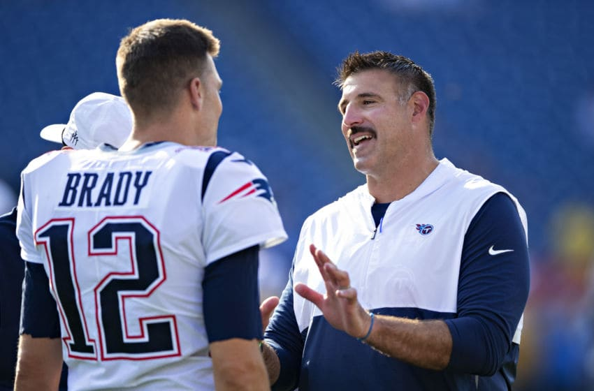 NASHVILLE, TN - AUGUST 17: Head Coach Mike Vrabel of the Tennessee Titans talks with Tom Brady #12 of the New England Patriots before a week two preseason game at Nissan Stadium on August 17, 2019 in Nashville, Tennessee. (Photo by Wesley Hitt/Getty Images)