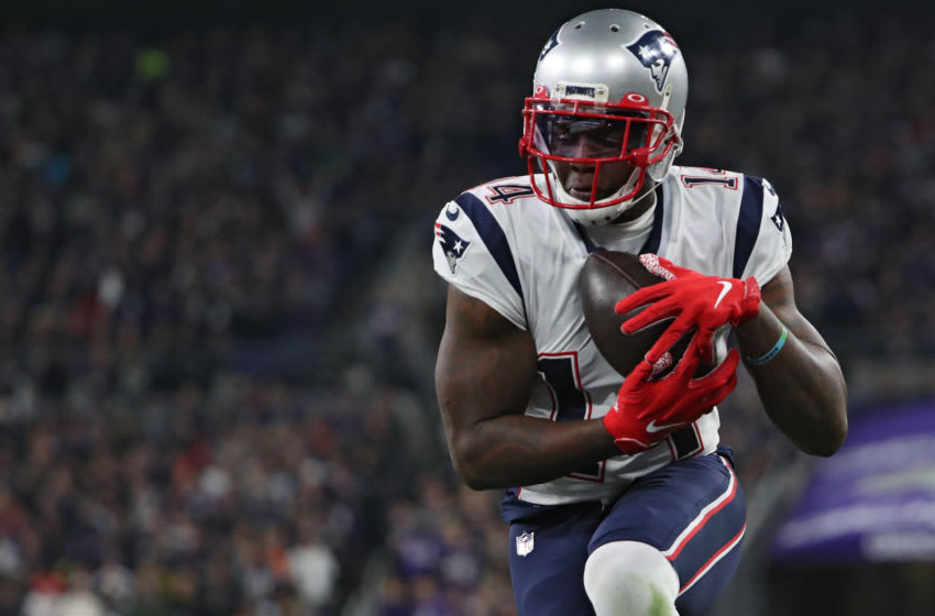 BALTIMORE, MARYLAND - NOVEMBER 03: Wide receiver Mohamed Sanu #14 of the New England Patriots scores a second quarter touchdown against the Baltimore Ravens at M&T Bank Stadium on November 3, 2019 in Baltimore, Maryland. (Photo by Todd Olszewski/Getty Images)