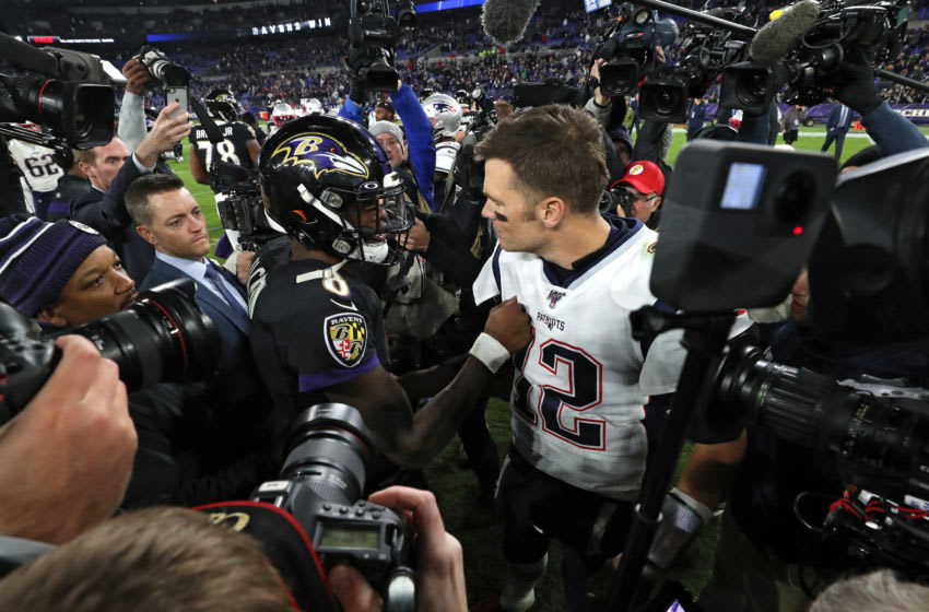 BALTIMORE, MARYLAND - NOVEMBER 03: Quarterback Lamar Jackson #8 of the Baltimore Ravens and quarterback Tom Brady #12 of the New England Patriots talk after the Ravens defeated the Patriots at M&T Bank Stadium on November 3, 2019 in Baltimore, Maryland. (Photo by Todd Olszewski/Getty Images)