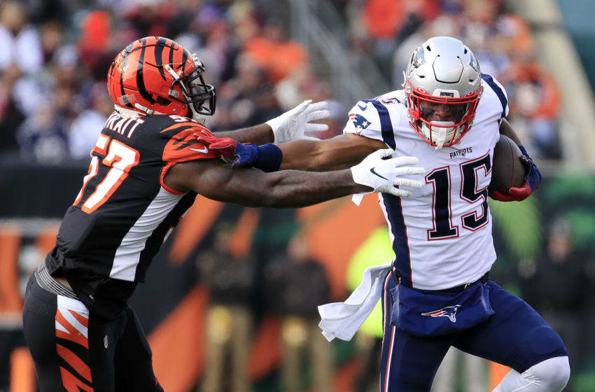 CINCINNATI, OHIO - DECEMBER 15: N'Keal Harry #15 of the New England Patriots runs with the ball as Germaine Pratt #57 of the Cincinnati Bengals is unable to make the tackle during the first half in the game at Paul Brown Stadium on December 15, 2019 in Cincinnati, Ohio. (Photo by Andy Lyons/Getty Images)