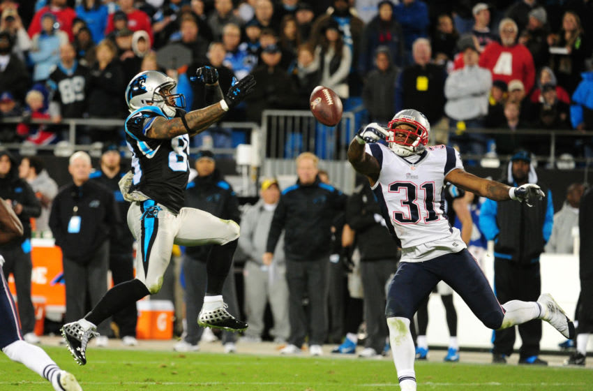 CHARLOTTE, NC - NOVEMBER 18: Aqib Talib #31 of the New England Patriots breaks up a pass intended for Steve Smith #89 of the Carolina Panthers at Bank of America Stadium on November 18, 2013 in Charlotte, North Carolina. (Photo by Scott Cunningham/Getty Images)