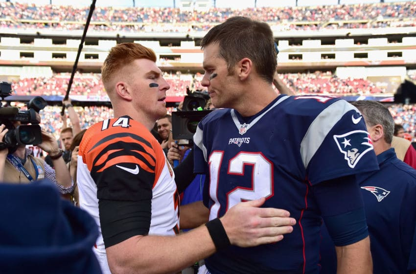 FOXBORO, MA - OCTOBER 16: Tom Brady #12 of the New England Patriots reacts with Andy Dalton #14 of the Cincinnati Bengals following a game against the Cincinnati Bengals at Gillette Stadium on October 16, 2016 in Foxboro, Massachusetts. (Photo by Billie Weiss/Getty Images)