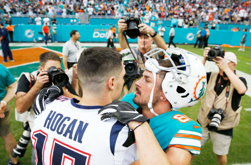 MIAMI, FL - DECEMBER 09: Chris Hogan #15 of the New England Patriots congratulating Danny Amendola #80 of the Miami Dolphins after the Miami Dolphins defeat the New England Patriots 34-33 at Hard Rock Stadium on December 9, 2018 in Miami, Florida. (Photo by Michael Reaves/Getty Images)