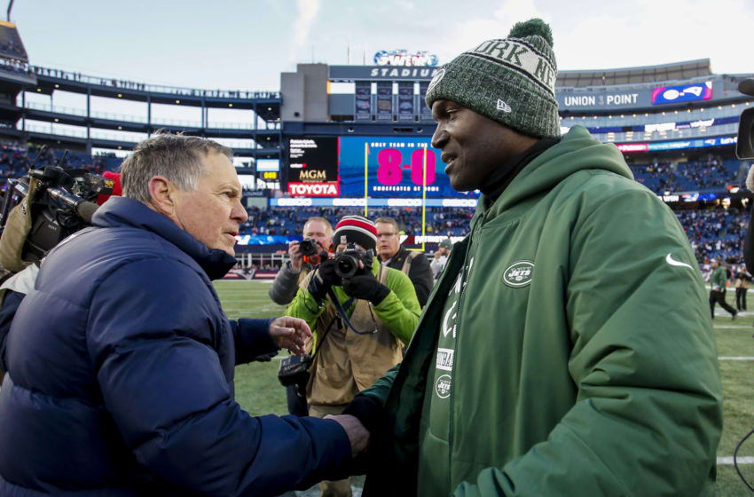 FOXBOROUGH, MASSACHUSETTS - DECEMBER 30: Head coach Todd Bowles of the New York Jets hugs head coach Bill Belichick of the New England Patriots after a game at Gillette Stadium on December 30, 2018 in Foxborough, Massachusetts. (Photo by Jim Rogash/Getty Images)