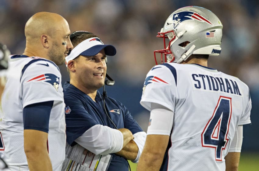 NASHVILLE, TN - AUGUST 17: Offensive coordinator Josh McDaniels talks with Jarrett Stidham and Brian Hoyer #2 of the New England Patriots during a week two preseason game against the Tennessee Titans at Nissan Stadium on August 17, 2019 in Nashville, Tennessee. The Patriots defeated the Titans 22-17. (Photo by Wesley Hitt/Getty Images)