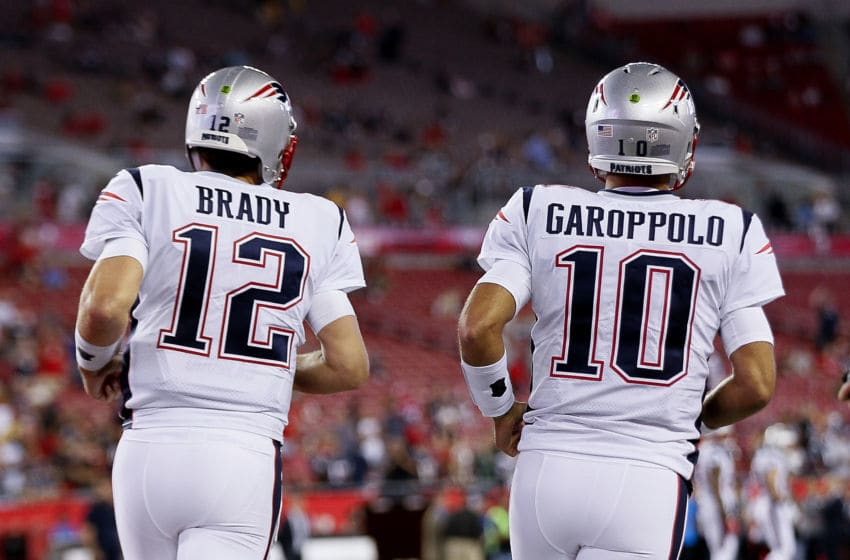TAMPA, FL - OCTOBER 5: A backview of Quarterbacks Tom Brady #12 and Jimmy Garoppolo #10 of the New England Patriots as they enter the field for pre-game warm-ups before the game against the Tampa Bay Buccaneers at Raymond James Stadium on October 5, 2017 in Tampa, Florida. The Patriots defeated the Buccaneers 19-14. (Photo by Don Juan Moore/Getty Images)