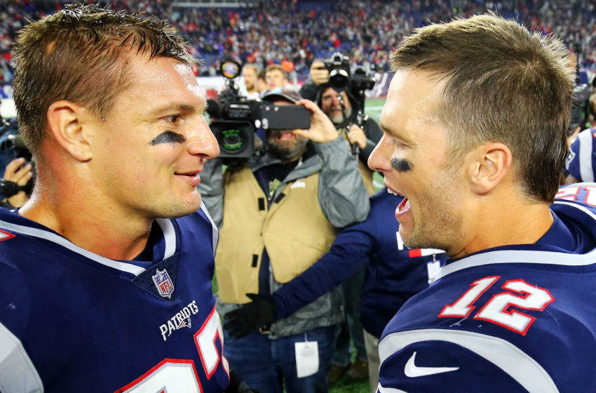 FOXBOROUGH, MA - OCTOBER 14: Tom Brady #12 talks to Rob Gronkowski #87 of the New England Patriots after a victory over the Kansas City Chiefs at Gillette Stadium on October 14, 2018 in Foxborough, Massachusetts. (Photo by Adam Glanzman/Getty Images)