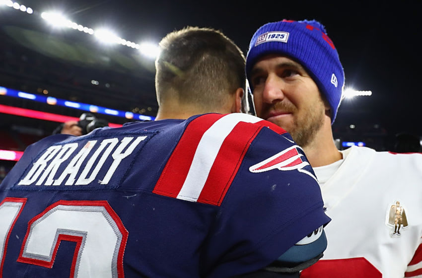 FOXBOROUGH, MASSACHUSETTS - OCTOBER 10: Tom Brady #12 of the New England Patriots shakes hands with Eli Manning #10 of the New York Giants after their game at Gillette Stadium on October 10, 2019 in Foxborough, Massachusetts. The New England Patriots defeated the New York Giants with a score of 35 to 14. (Photo by Adam Glanzman/Getty Images)