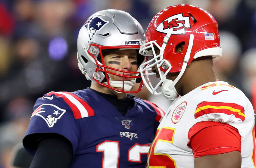 FOXBOROUGH, MASSACHUSETTS - DECEMBER 08: Tom Brady #12 of the New England Patriots confronts Chris Jones #95 of the Kansas City Chiefs during their game at Gillette Stadium on December 08, 2019 in Foxborough, Massachusetts. (Photo by Maddie Meyer/Getty Images)