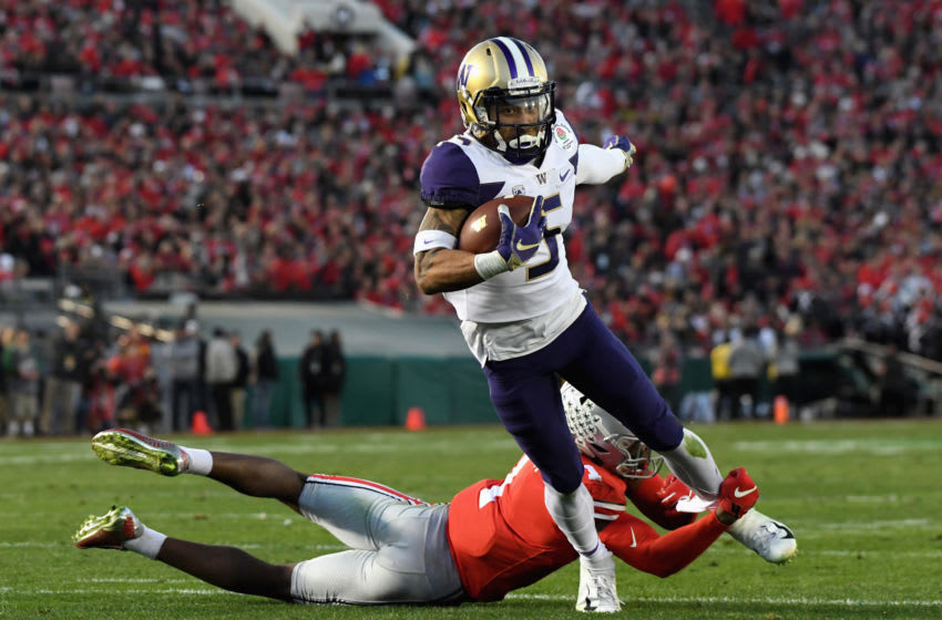Jeffrey Okudah #1 of the Ohio State Buckeyes attempts to tackle Andre Baccellia #5 of the Washington Huskies during the second half in the Rose Bowl Game presented by Northwestern Mutual at the Rose Bowl on January 1, 2019 in Pasadena, California. (Photo by Harry How/Getty Images)