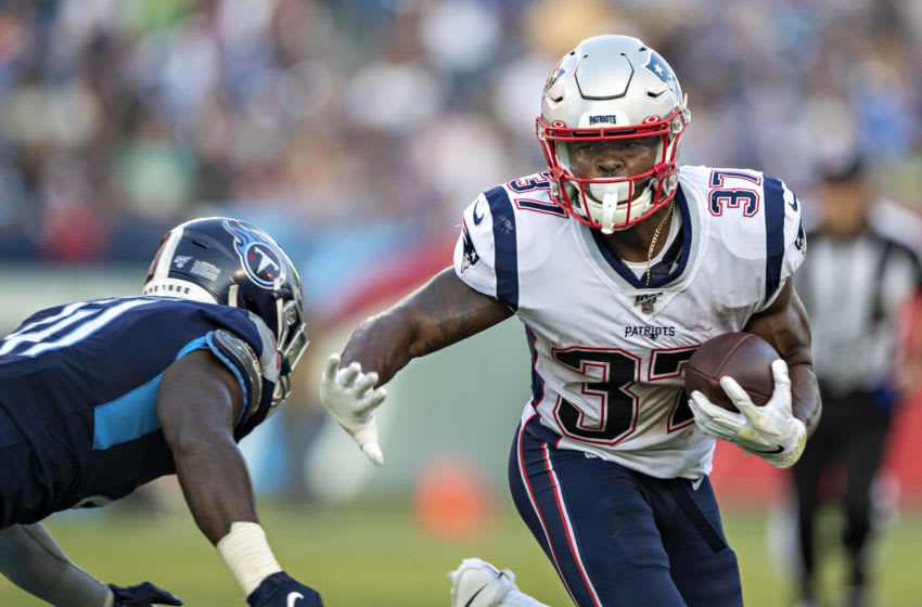 Damien Harris #37 of the New England Patriots runs the ball during a game against the Tennessee Titans during week two of the preseason at Nissan Stadium on August 17, 2019 in Nashville, Tennessee. The Patriots defeated the Titans 22-17. (Photo by Wesley Hitt/Getty Images)