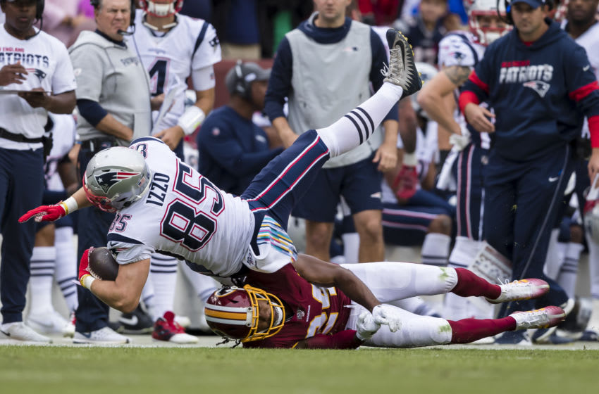Ryan Izzo #85 of the New England Patriots is tackled by Josh Norman #24 of the Washington Redskins during the first half at FedExField on October 6, 2019 in Landover, Maryland. (Photo by Scott Taetsch/Getty Images)
