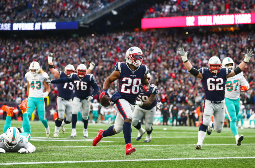 James White #28 of the New England Patriots scores a touchdown in the fourth quarter of a game against the Miami Dolphins at Gillette Stadium on December 29, 2019 in Foxborough, Massachusetts. (Photo by Adam Glanzman/Getty Images)