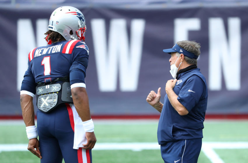 Cam Newton #1 of the New England Patriots talks with head coach Bill Belichick before the game against the Miami Dolphins at Gillette Stadium on September 13, 2020 in Foxborough, Massachusetts. (Photo by Maddie Meyer/Getty Images)