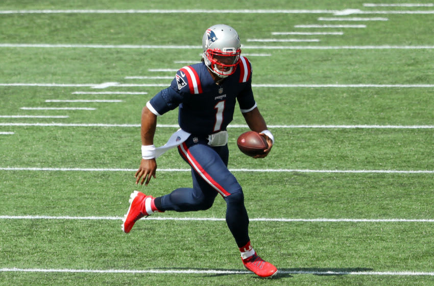 FOXBOROUGH, MASSACHUSETTS - SEPTEMBER 13: Cam Newton #1 of the New England Patriots runs with the ball during the first half against the Miami Dolphins at Gillette Stadium on September 13, 2020 in Foxborough, Massachusetts. (Photo by Maddie Meyer/Getty Images)