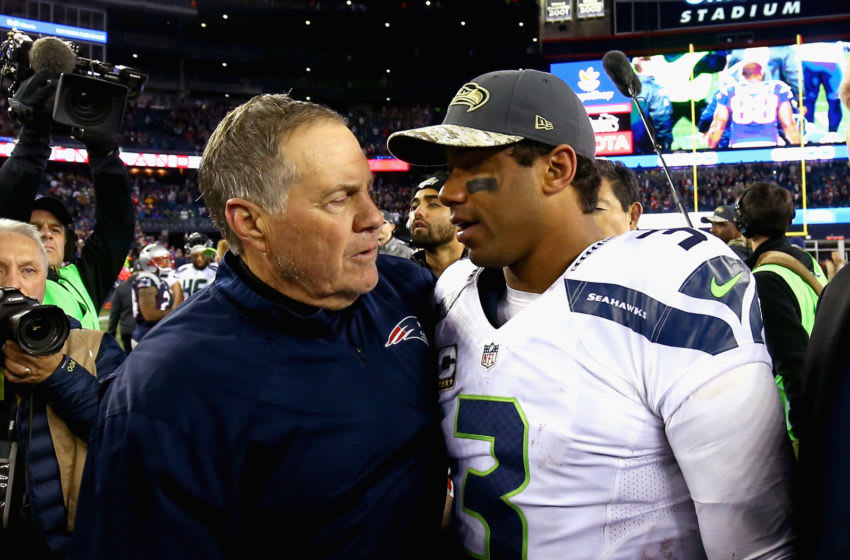 Head coach Bill Belichick shakes hands with Russell Wilson #3 of the Seattle Seahawks after a game at Gillette Stadium on November 13, 2016 in Foxboro, Massachusetts. (Photo by Adam Glanzman/Getty Images)