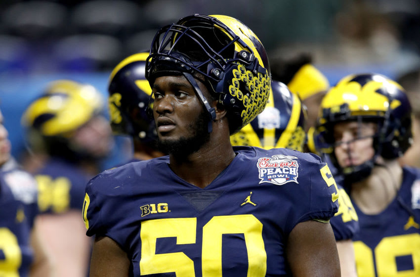 ATLANTA, GEORGIA - DECEMBER 29: Michael Onwenu #50 of the Michigan Wolverines looks on during warm ups prior to the Chick-fil-A Peach Bowl against the Florida Gators at Mercedes-Benz Stadium on December 29, 2018 in Atlanta, Georgia. (Photo by Joe Robbins/Getty Images)