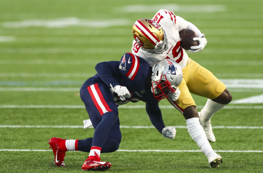 FOXBOROUGH, MASSACHUSETTS - OCTOBER 25: Deebo Samuel #19 of the San Francisco 49ers is tackled with the ball during a game against the New England Patriots on October 25, 2020 in Foxborough, Massachusetts. (Photo by Adam Glanzman/Getty Images)