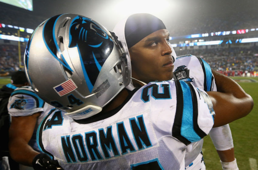 CHARLOTTE, NC - JANUARY 03: Josh Norman #24 and Cam Newton #1 of the Carolina Panthers congratulate each other on their 27-16 win over the Arizona Cardinals after their NFC Wild Card Playoff game at Bank of America Stadium on January 3, 2015 in Charlotte, North Carolina. (Photo by Streeter Lecka/Getty Images)