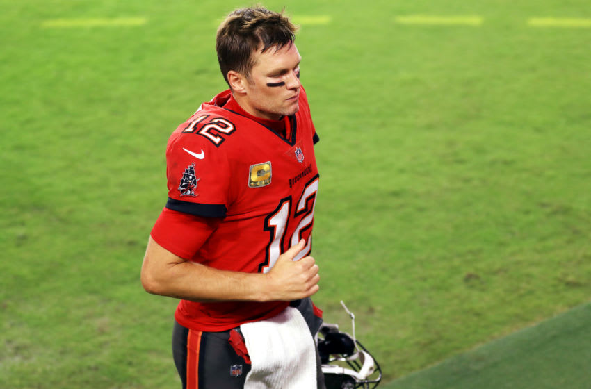TAMPA, FLORIDA - NOVEMBER 08: Tom Brady #12 of the Tampa Bay Buccaneers jogs off the field after being defeated by the New Orleans Saints 38-3 at Raymond James Stadium on November 08, 2020 in Tampa, Florida. (Photo by Mike Ehrmann/Getty Images)