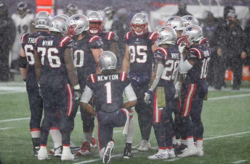 FOXBOROUGH, MASSACHUSETTS - NOVEMBER 15: Cam Newton #1 of the New England Patriots huddles the offense in the rain against the Baltimore Ravens during the second half at Gillette Stadium on November 15, 2020 in Foxborough, Massachusetts. (Photo by Maddie Meyer/Getty Images)