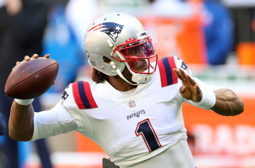 HOUSTON, TEXAS - NOVEMBER 22: Cam Newton #1 of the New England Patriots warms up prior to their game against the Houston Texans at NRG Stadium on November 22, 2020 in Houston, Texas. (Photo by Carmen Mandato/Getty Images)